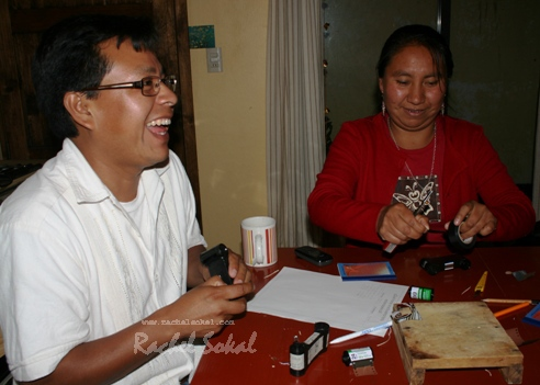 Xuno Lopez Intzin and Antonia Santiz Giron, both Tzeltal speaking photographers originally from Tenejapa, laughing (probably at my terrible Tzeltal!) whilst making their matchbox cameras. 30.3.10