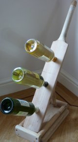 Upcycled Cricket bat wine rack.