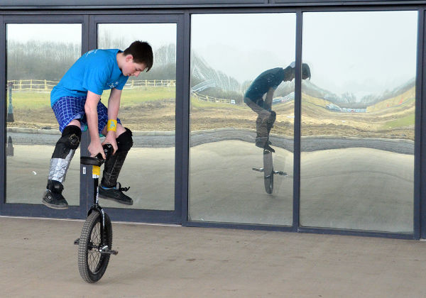 Unicycle handstand