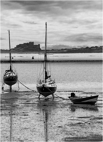 Boats and Bamburgh Castle