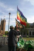 Brian Haw holds peace flag