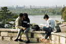 Students kiss in a park overlooking the River Sava in Belgrade, Serbia. 2001.