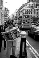 City of London, UK, 2001. A man reads an evening newspaper reporting on that days attacks on the World Trade Centre in New York.