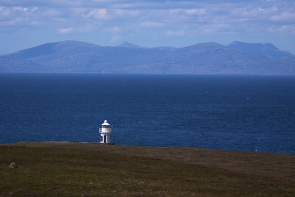 Waternish Lighthouse with Harris in distance