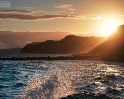 Sunset and Splashing Waves