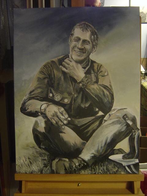 McQueen portrait on easel