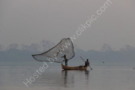 Fisherman Casting His Net