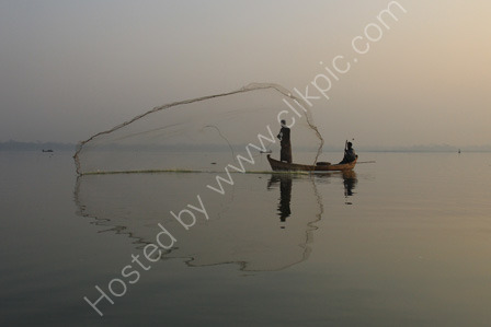 Fisherman with net on Lake