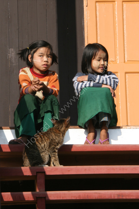Children Waiting on the School Steps