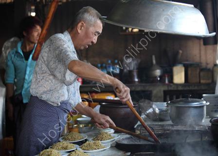 Cooking Noodles at Market