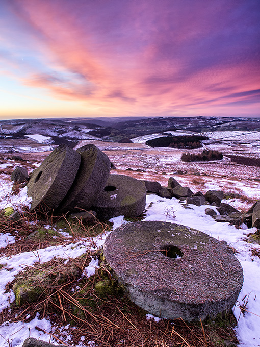 Winter dawn over millstones on Stanage