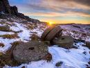 Winter sunrise over millstones on Stanage