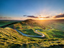 Sunset over the winding road
