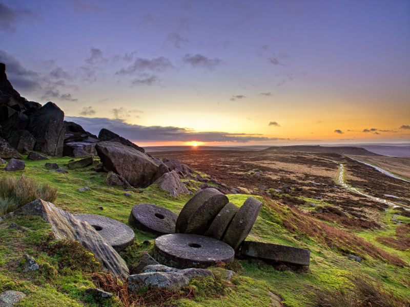 Sunrise over millstones on Stanage
