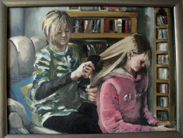 A Mother brushing her daughters hair.