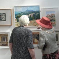 The Mayoress of Worthing and the Secretary of the SSP Helen Armstrong in conversation about paintings by Barry Hinchliff, President of the SSP