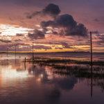 Stormy sunrise Lindisfarne Causeway