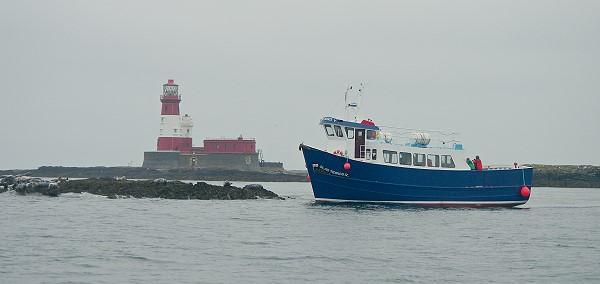 Pleasure Boat Passing Longstone Lighthouse