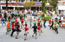 School children rehearsing for public event in Hanioti. (b).