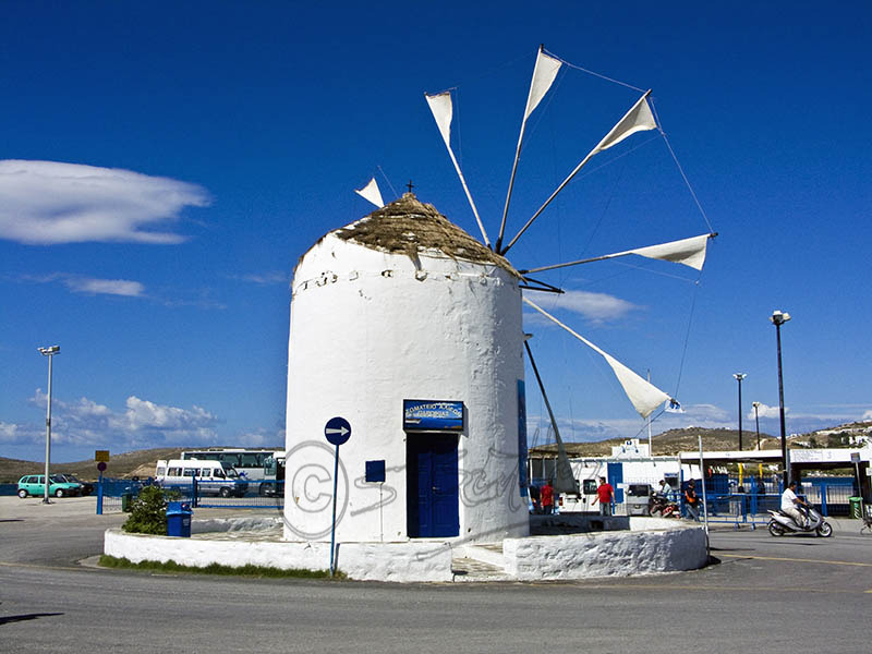 Windmill on sea front in Paroikia.