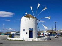 Windmill on sea front in Paroikia.