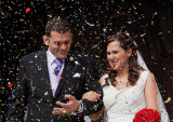 Bride and Groom under confetti by London Wedding Photographer Philip Pound