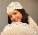 Bride wearing her grandmother's antique wedding veil at her wedding by London Wedding Photographer Philip Pound