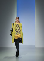Fashion model in yellow on the catwalk at the Shape Up Fashion Show