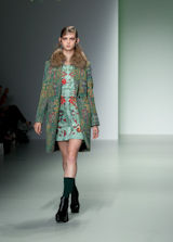 Fashion Model on the Catwalk in Green
