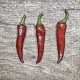 Chillies on wood