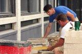 Stonemasons at work.