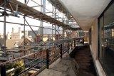 The balcony scaffolding.