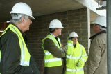 Mr Colin Holmes (then Domestic Bursar) and Mr John Harrison inspect their investment.