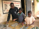 Oumar with two of the children