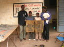 Oumar and Bassidy with two young students