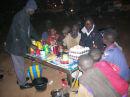 Kader feeds children at night