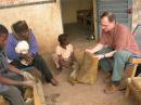 Bassidy teaching Tim how to rub the dried mud off.