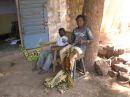 Dra and Papou stitching bogolan cloth