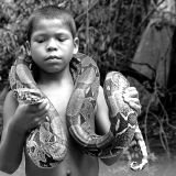 Amazon boy with snake