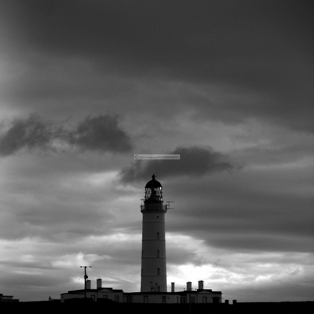 The Rhinns Lighthouse on black sky