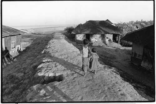 Sandwip island, Bangladesh, brother and sister on embankment