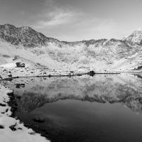 Winter reflections of Snowdon and Y Lliwedd from Llyn Llydaw