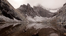 Reflection of early snow on Lake Agnes