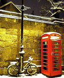 Order No X030: Season's Greetings! A snow-covered phone box and bicycle in the High Street, Oxford