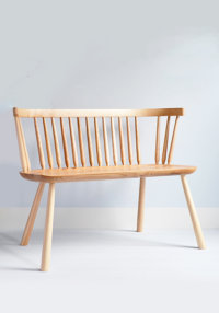 Pembroke bench in ash with an elm seat designed by Sarah Kay