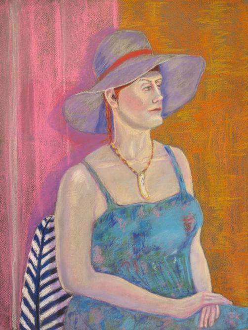Model wearing lilac hat