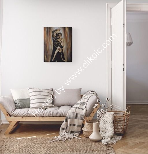 A painting of a couple dancing the tango on the wall over a sofa