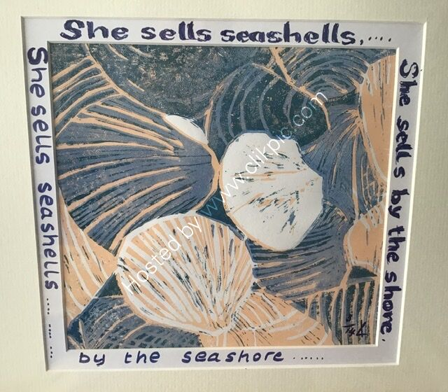 A linocut print showing seashells, peach and blue grey, writing around mount