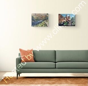 Two landscape paintings shown in a room setting
