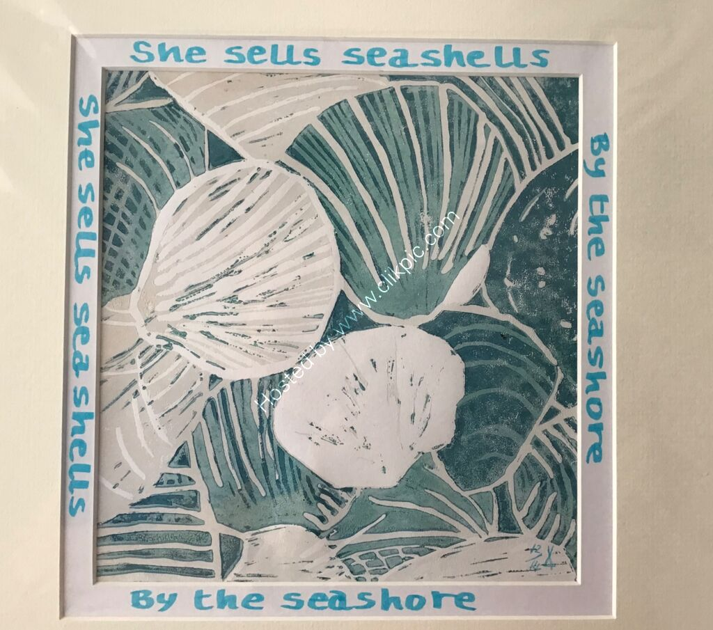 A linocut print showing seashells, peach and teal blues, writing around mount
